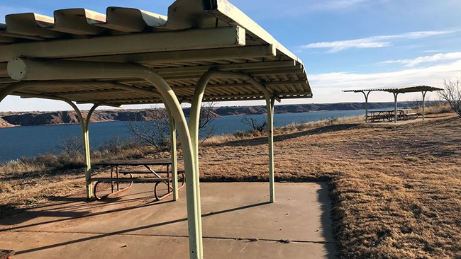 Image of two campsites with Lake Meredith in the background