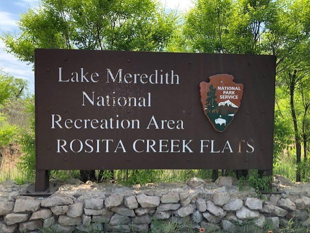 Brown Sign entering Rosita Campground areas.  It is a sunny day and there are large trees in the area.