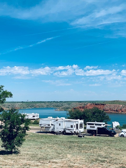 View of campers on the Rim of Sanford Yake.  It is a sunny day with blue skies.