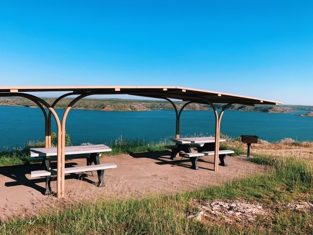 Two picnic tables at Fritch Fortress overlooking the lake.
