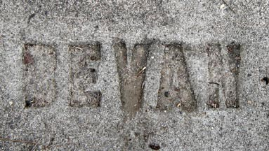 The name Bevan etched in concrete.