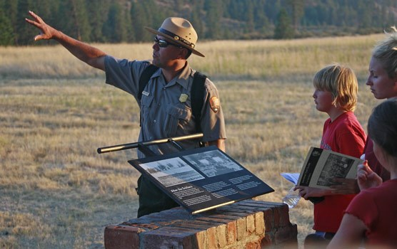 Children's Program. A ranger points out important resources on a tour.