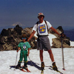 Adult and child skier on summit of Lassen Peak