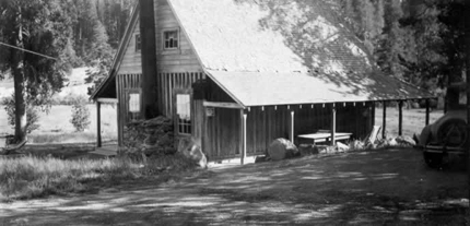 black and white photo showing rustic cabin in 1931