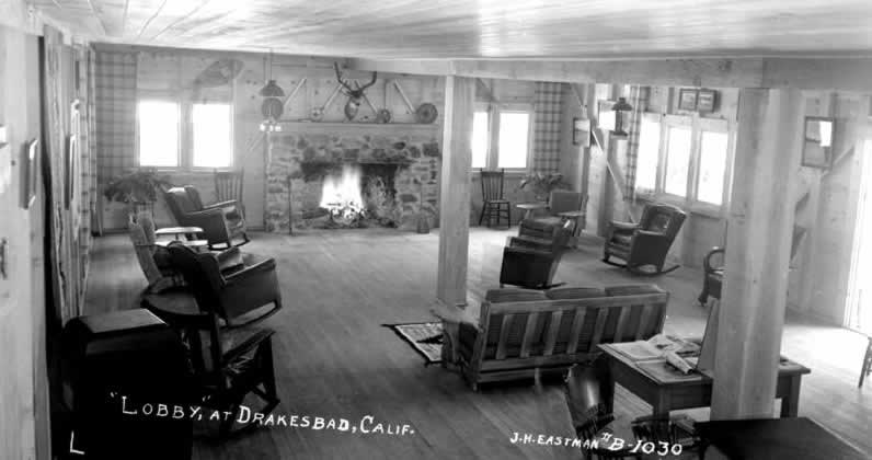 interior of lodge in 1939 with wood floors, fireplace, and rocking chairs