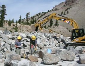 Park trail crew move prepare stone from a nearby quarry
