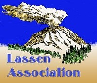 "A volcano with smoke rising from the summit with the words ""Lassen Association."""