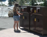 A girl recycles outside the Kohm Yah-mah-nee Visitor Center