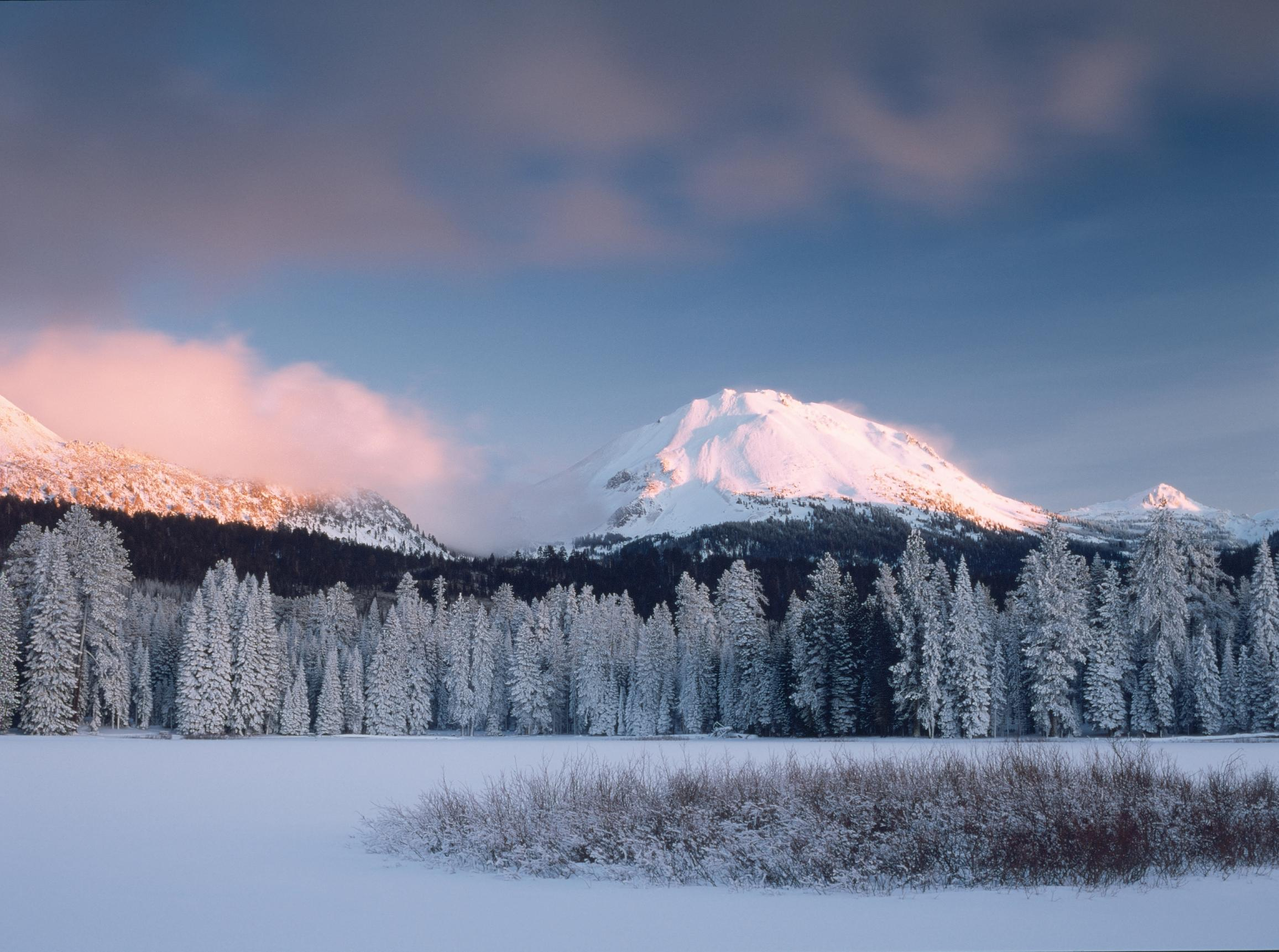 winter image with fresh snow over lake and Lassen Peak in background