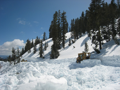 Heavy equipment cuts road into deep snow near the Sulphur Works