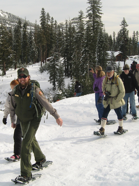 Ranger leads group on snowshoes from Kohm Yah-mah-nee Visitor Center.