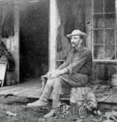 Edward Drake at his cabin in 1887