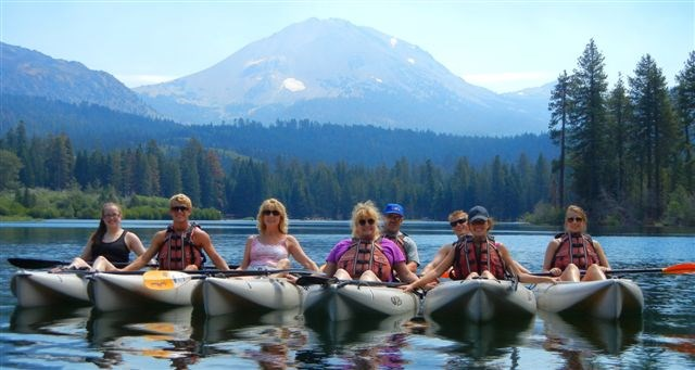 Group of kayakers on Manzanita Lake, Lassen Peak in background.