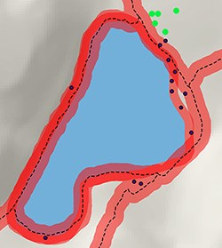 A map with red highlight along shoreline and trail indicating areas not appropriate for camping.