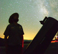 A park ranger gazes at the Milky Way
