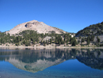 Lassen Peak reflecting in the calm blue waters of Lake Helen