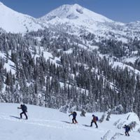 Backcountry skiers enjoy a view of Lassen Peak