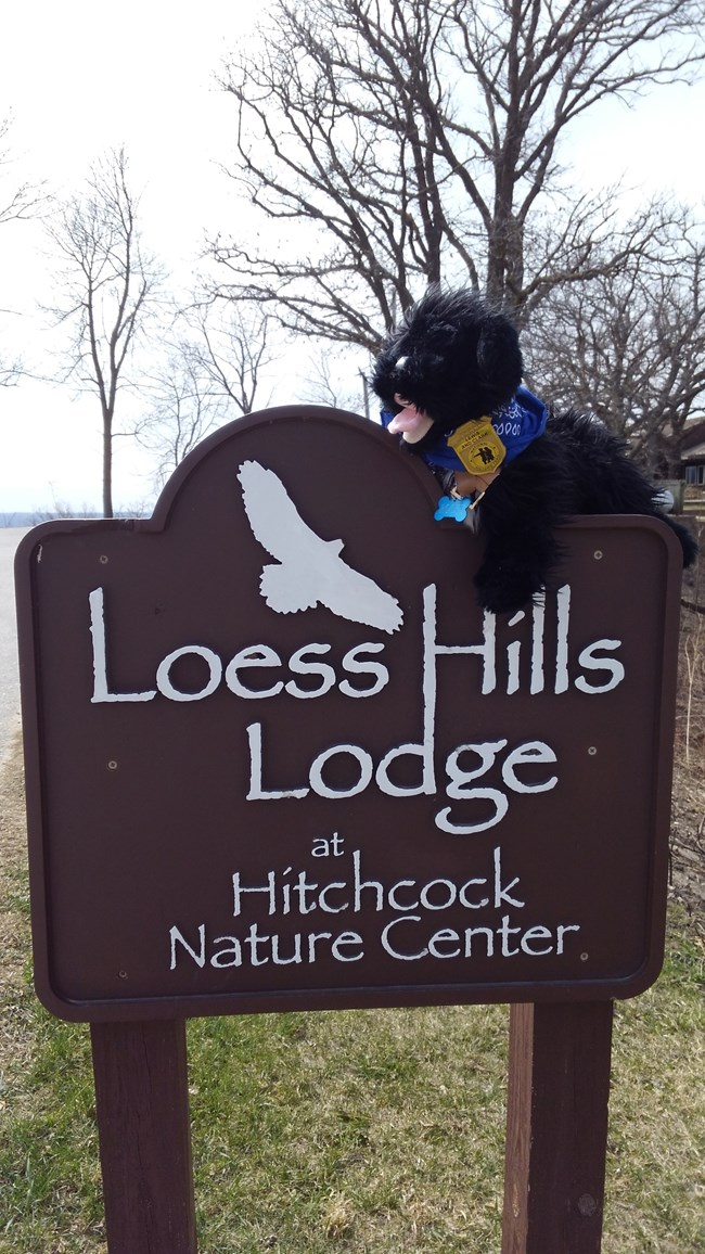 stuffed pup on Loess Hills Lodge sign