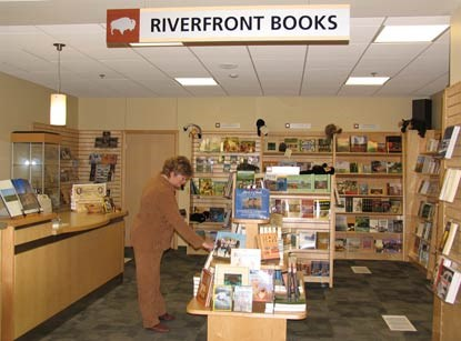 A shopper browses in Riverfront Books.