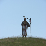 A metal sentinel of a Mandan, Hidatsa, or Arikara Indian guiding visitors to the Earth Lodge Village of the Three Affiliated Tribes of New Town, North Dakota