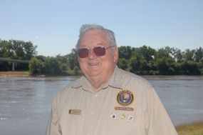 photo of Dr. Carl Camp standing in front of the Missouri River in Omaha Nebraska