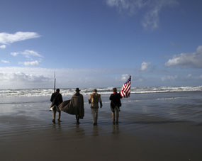 Lewis and Clark reenactors approach the Pacific Ocean.