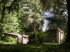 Fort Clatsop, a log fort, surrounded by forest.