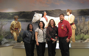 Nichole McHenry, Karla Sigala, and Jill Hamilton-Anderson visiting with museum director James Payne of the Fort Walla Walla Museum in Washington state.