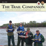 volunteers participating in sturgeon survey on Missouri River holding sturgeon and posing