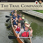 photo of canoe with kids and a ranger on front cover of The Trail Companion December 2013