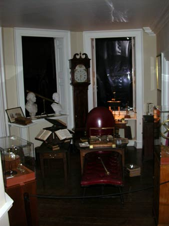 Cabinet room at Monticello with red leather chair, writing table, books and grandfather clock.
