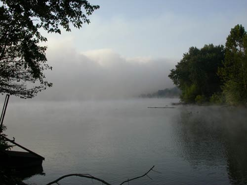 Ohio River with fog rising off the surface of the water.