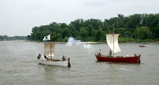 Replicas of red pirogue and white pirogue on the Missouri River in Omaha, NE.