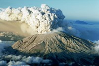 Mount St. Helens. Large conical shaped mountain with a large ash cloud erupting from the top.