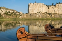 Two Canoes on the banks of the Missouri River at White Cliffs in Montana.