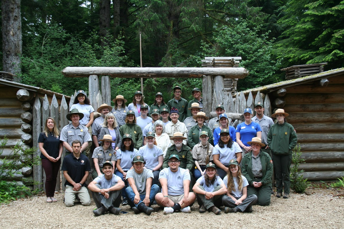 Staff, Interns, and volunteers standing in front of Fort Clatsop
