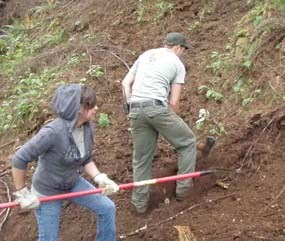 YCC student Angelica & Park Ranger Josh raking and building South Clatsop Slough trail.