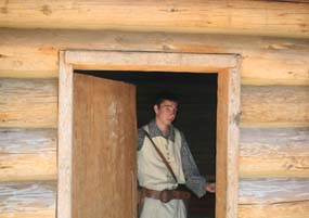 YCC student Roland standing in the doorway of Fort Clatsop