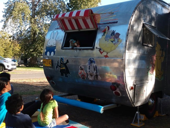 Puppet Show Trailer performing for children