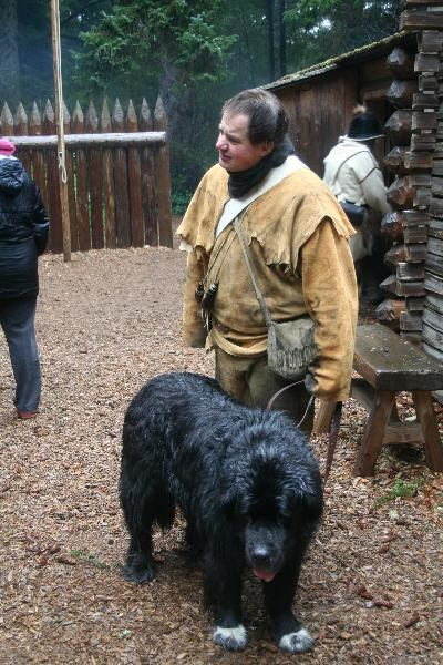 Ranger in busckskins with newfoundland at fort in the rain