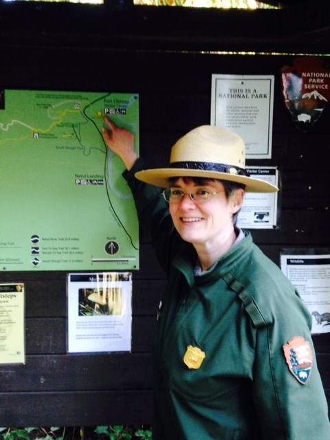 Park Ranger Sally pointing to trail map.