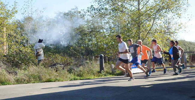 Runners taking off after musket fire