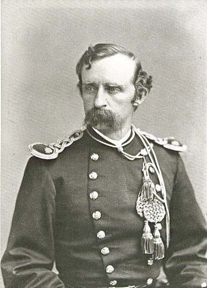 Black and white portrait of Lt Col George Armstrong Custer in uniform.