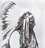 Chief Sitting Bull side portrait with headdress.