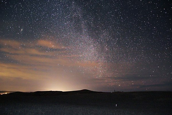 Light pollution and the milky way can both be seen at night at the monument.