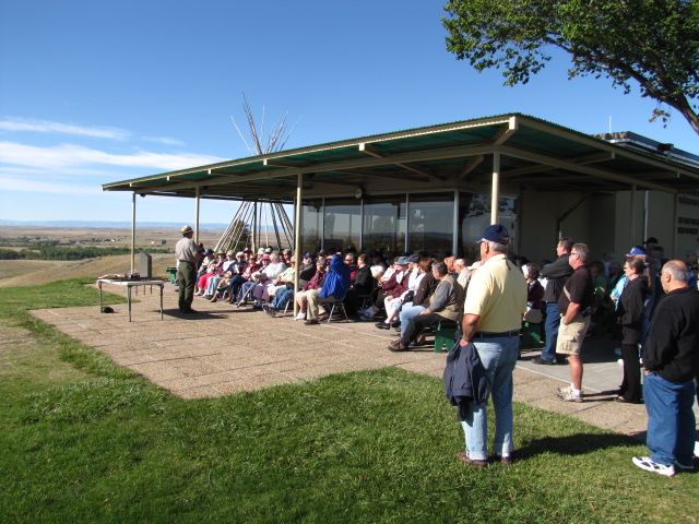 A ranger gives a talk to a group of visitors on the Visitor Center patio.