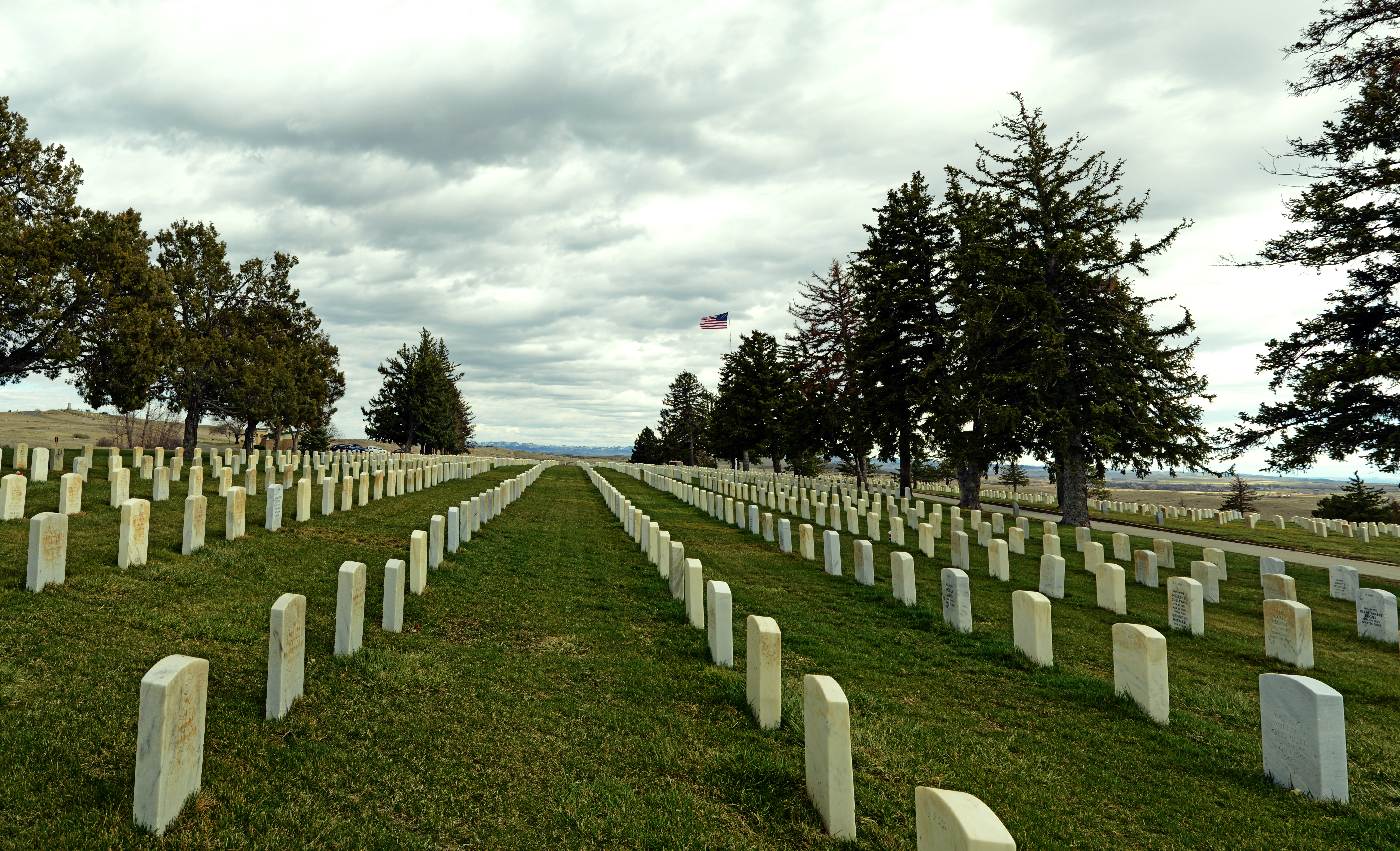 Custer National Cemetery with American flag in background.