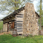 Cabin at the Living Historical Farm in springtime