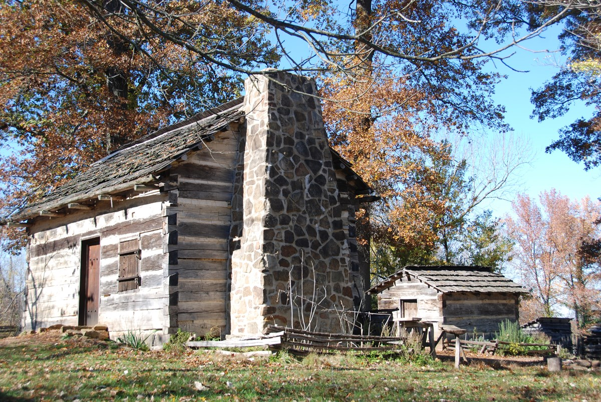 Re-created 1820s homestead with cabin and outbuildings