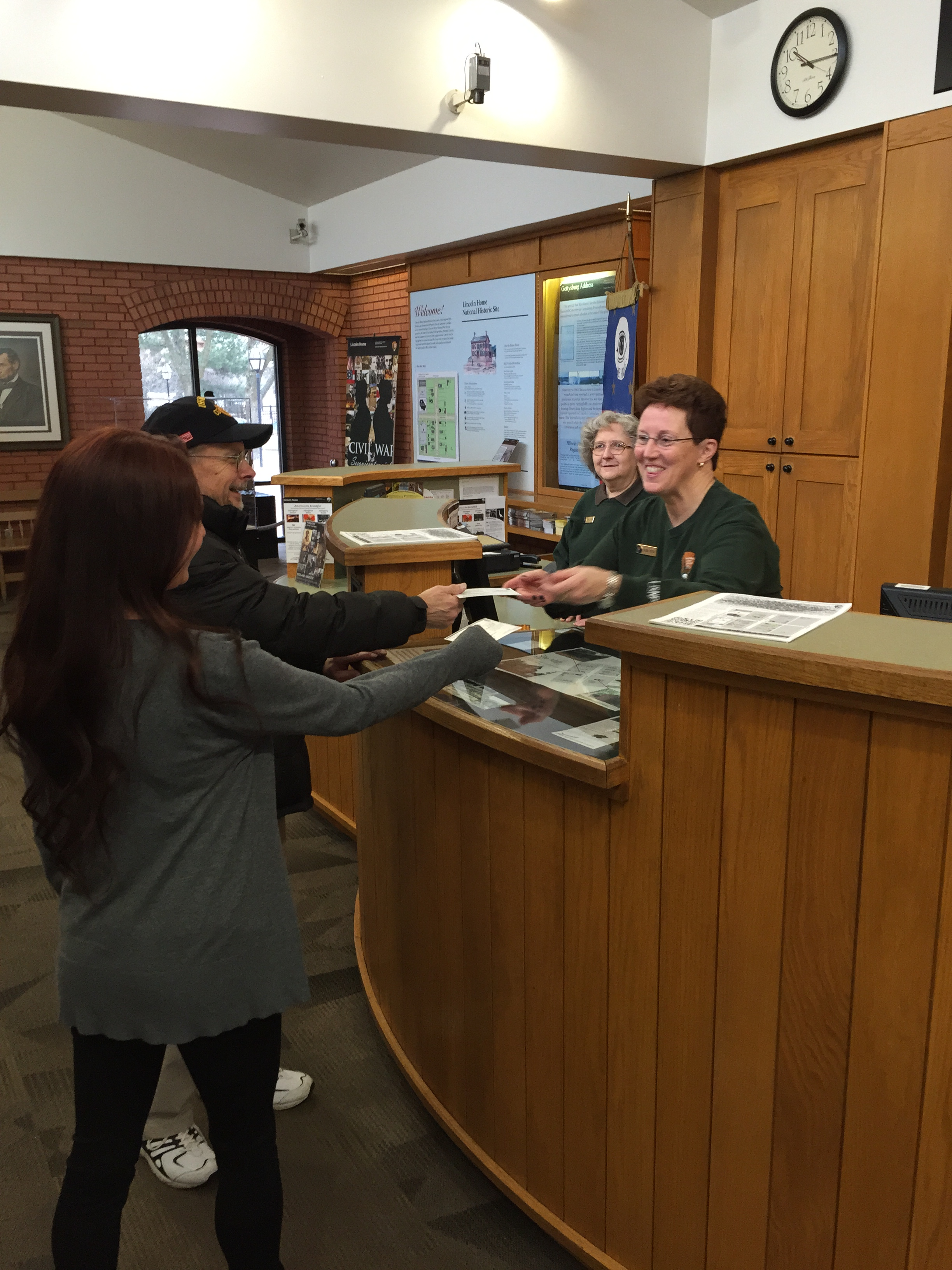 two front desk volunteers interacting with visitors